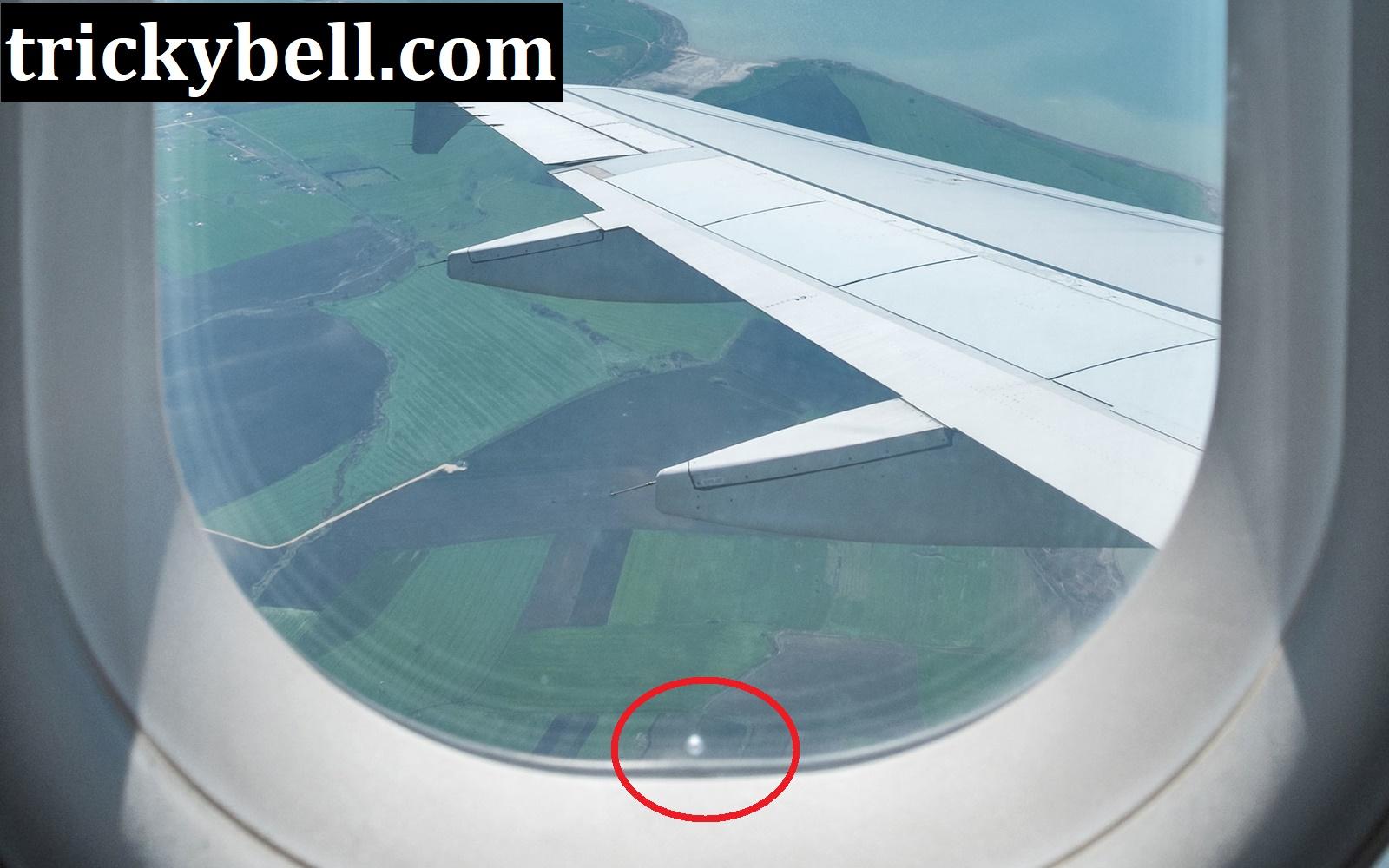 Why Aeroplane Windows Have A Tiny Hole at the Bottom?